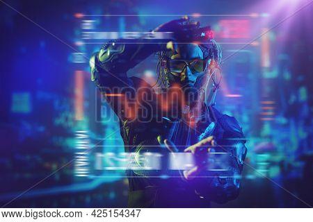 Game, virtual reality. A cyberpunk warrior of the future controls a digital hologram. Future technologies.