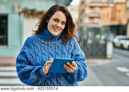 Young irish plus size girl using touchpad at the city.