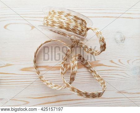 Jute Linen Braid On A Light Background With A Wooden Texture.