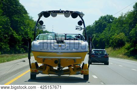 Bowling Green, Kentucky, U.s.a - June 16, 2021 - A Truck Towing A Boat On The Highway Interstate 65