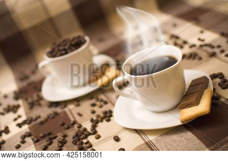 Two Coffe Cups On Table, Second One Blurred In Background