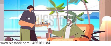 Friendly Nurse Or Volunteer Bringing Pills To Elderly Man Patient Home Care Services Healthcare And