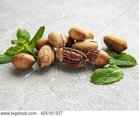 Pecan Nuts On A Grey Concrete Background