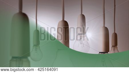 Animation of person holding light bulbs with green overlay. global green energy, digital interface, technology and networking concept digitally generated video.