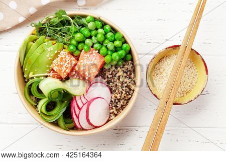 Poke bowl with salmon, cucumber and avocado. Traditional hawaiian meal. Top view flat lay