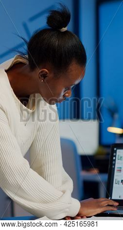 Stressed African Manager Woman Working With Financial Documents Checking Graphs, Holding Papers, Rea