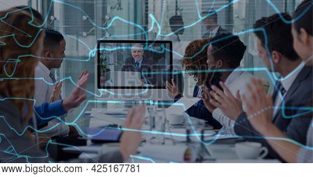 Composition of network of digital lines over people clapping in business video meeting. global business, digital interface, technology and networking concept digitally generated image.