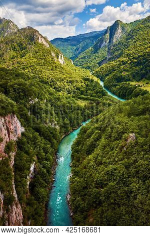 Green valley nature landscape. Mountain layers nature landscape. Springtime in mountain nature landscape. River and mountains nature landscape. Blue mountains layers landscape. Beauty in nature. Landscape. Mountains. Valley nature.Nature