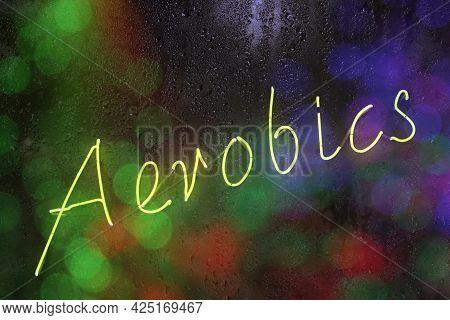 Neon Aerobics Sign In Rainy Window With Bokeh