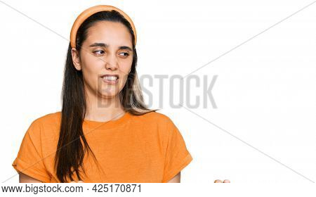 Young hispanic woman wearing casual clothes disgusted expression, displeased and fearful doing disgust face because aversion reaction.