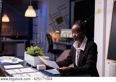 Focused Workaholic African American Businesswoman Working At Company Financial Charts Presentation L