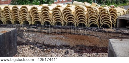 Round Insulation For Thermal Insulation Of Heating Pipes. Repair Work In The City, The Road Is Dug U