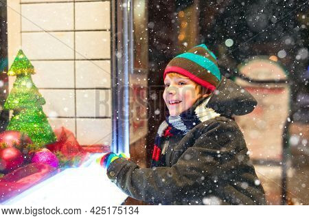 Cute Little Healthy School Kid Boy On Christmas Market. Funny Happy Child In Fashion Winter Clothes