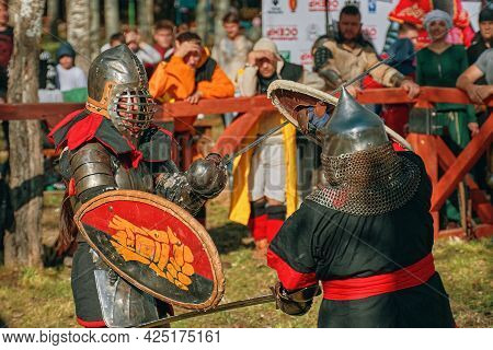 Fights Among Women In Armor. Two Females Warrior Fighting In Competition Of Warriors. Festival Of Me