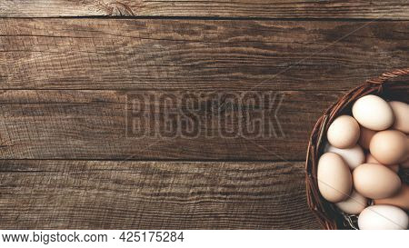 Flat Lay With Basket Full Of Organic Chicken Eggs On Wooden Background. Organic Household Concept Wi