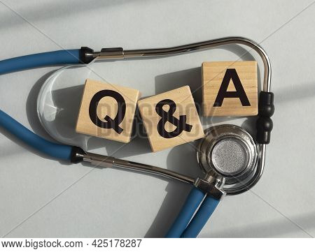 Q And A Acronym On Blocks. Question About Hospital, Health, Medicare Concept. Qna.