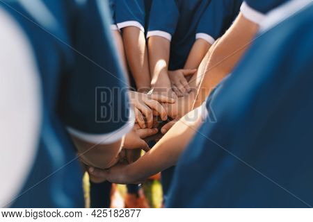 Sports Team Stacking Hands Together In A Group. Happy Children Teammates Motivated In A Team. Team B
