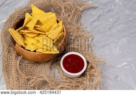 Corn Chips Nachos And Tomato Salsa. Top View.
