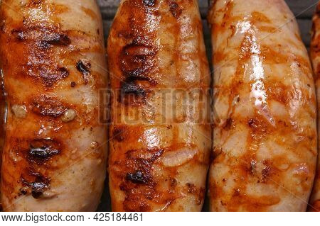 Close-up View Of Fried Sausages. Meat Fish. Cooking Food
