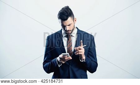 Thoughtful Businessman Showing Attention Gesture While Using Cellphone Isolated On White
