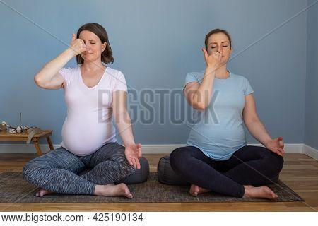 Pregnant Fitness Person Practicing Yoga At Home. Prenatal Pranayama.