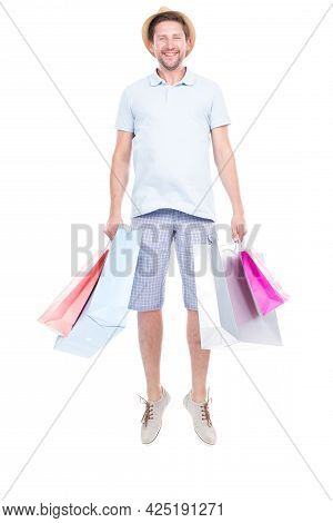 Vertical Full Length Studio Portrait Of Handsome Man Wearing Summer Outfit Carrying Shopping Bags, W