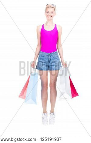 Vertical Full Length Studio Portrait Of Stylish Young Woman Wearing Summer Outfit Carrying Shopping