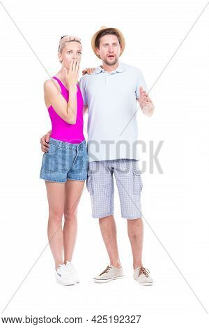 Vertical Full Length Studio Portrait Of Young Adult Caucasian Man And Woman Astonished At Something,