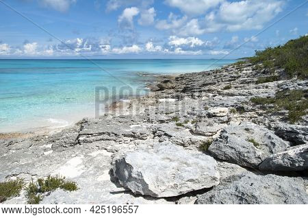 The Scenic View Of Half Moon Cay Rocky Shore And Colorful Caribbean Sea Waters (bahamas).