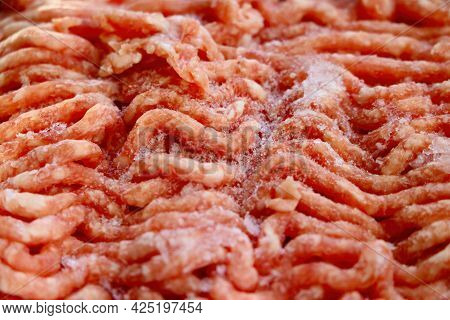 Close-up On Red Frozen Minced Meat. Background, Texture Of Meat