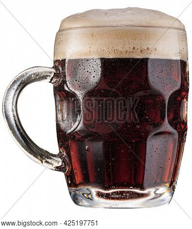 Mug of malt dark beer a large head of beer foam isolated on white background. File contains clipping path.