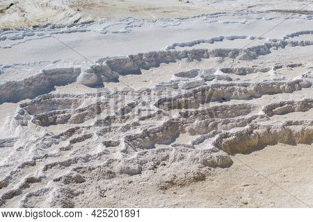 Close View Onto Ribs Of Travertine Terrace. Structure Created By Water Containing Carbonate Minerals