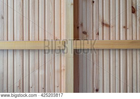 The Inner Side Of The Partition Is Made Of Wooden Lining. The Cross From The Bars Of The Frame Divid