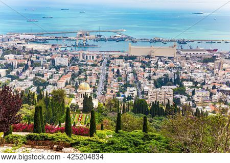 HAIFA, ISRAEL - MAY 6, 2017: Bahai World Center. Pilgrimage center and popular tourist destination. View from Mount Carmel to the seaport of Haifa. Sunny day by Mediterranean Sea.