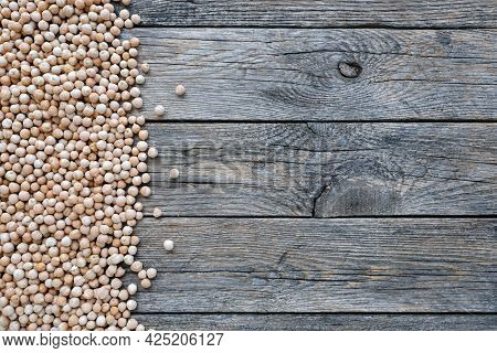 Uncooked Dried Legume Chickpeas Or Garbanzo Bean On Wooden Background. Vegetarian Super Food. Health