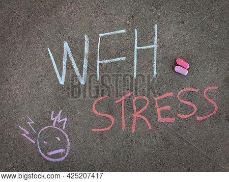 The Inscription Text On The Grey Board, Wfh (work From Home) Stress With Hand Drawn Stress Emoji. Us