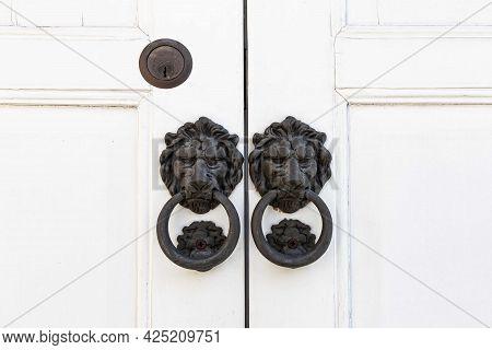 Variety Of Knockers And Handles On Ancient Doors, Old Metal Door Handle On A Wooden Door