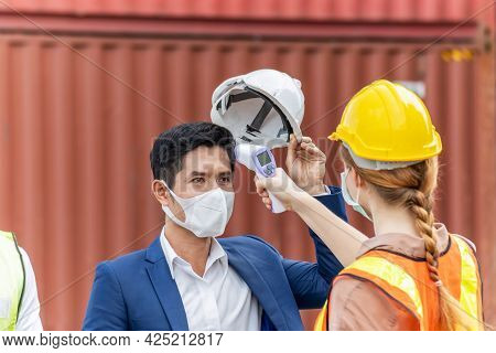 Factory Worker Woman Body Temperature Checking Fever By Digital Thermometer On Engineer Man With Car