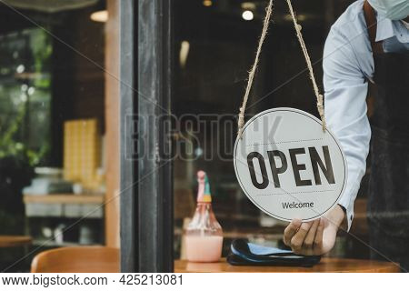 Reopen. Friendly Waitress Woman Staff Wearing Protection Face Mask Turning Open Sign Board Reopen Af