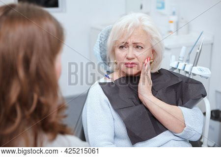 Elderly Woman Suffering From Toothache, Visiting Dentist