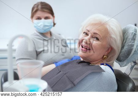Happy Elderly Lady Smiling To The Camera, After Dental Checkup At The Clinic