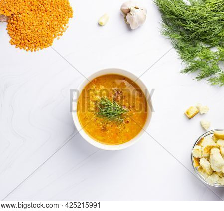 Red Lentil Soup With Ingredients On A Light Background. Traditional Turkish Or Arabic Spicy Lentil A