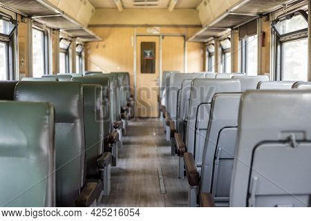 Interior Of A Passenger Train With Empty Seats. An Old Train Car From The Inside. Russian Railways.