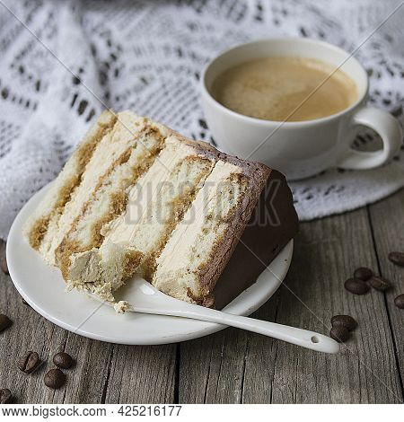 Tiramisu. A Slice Of A Traditional Italian Dessert On A White Plate And A Cup Of Coffee On A Marble