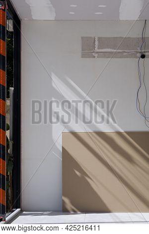 Gypsum Board On Tile Floor Inside Of The Old Office Room During Renovation Work
