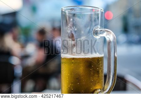 Half Empty Glass Of Light Beer In A Pub. Selective Focus