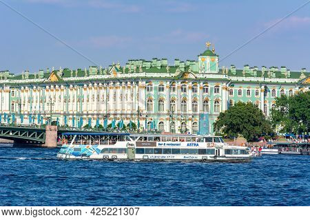 Saint Petersburg, Russia - June 2021: Winter Palace And Cruise Boat On Neva River