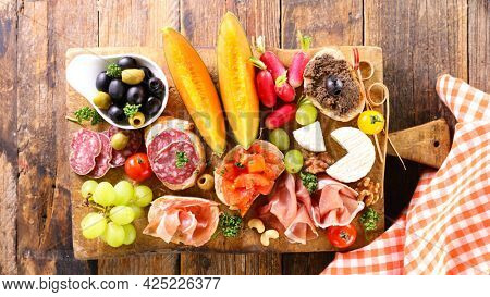 antipasto- buffet food on wooden board