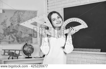 Mathematics. Back To School. Education In College. Mired In Geometry. School Girl Protractor And Tri