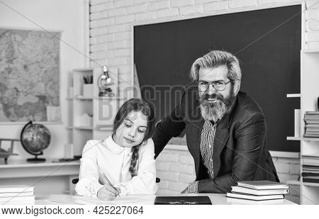 Study Together. Happy Teachers Day. Teacher And Schoolgirl On Lesson. Back To School. Little Girl An